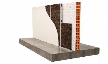 Изоляция стены из металлической стойки поверх кирпича